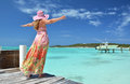 Exuma bahamas girl on the wooden jetty looking to the ocean Stock Image