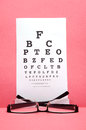 Eye chart test glass with on pink background Stock Photo