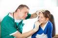 Eye Doctor Examining Young Gir...