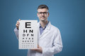 Eye exam professional optician holding an chart with letters Stock Photos