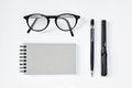 Eye glasses blank notepad pen and mechanical pencil on the table Royalty Free Stock Image