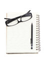 Eye glasses with mechanical pencil and binder note Royalty Free Stock Photo
