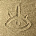 Eye handwriting in the sand square format Royalty Free Stock Images