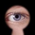 Eye looking through keyhole Royalty Free Stock Photo