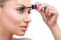 Eye make up woman with long eyelashes and mascara brush Stock Photography