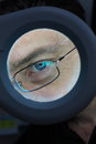 Eye portrait of a man behind magnifying lens Royalty Free Stock Photos