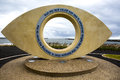 The eye in south shields modern sculpture on seafront with a view of piers at tynemouth and middle Royalty Free Stock Photos