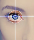 Eye technology medicine and vision concept focus on blue woman Stock Image