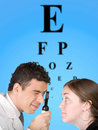 Eye test chart with doctor and patient Stock Images