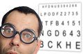 Eye test man with glasses and chart Stock Images