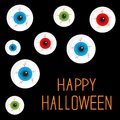 Eyeball set with bloody streaks. Black background. Happy Halloween card. Flat design style. Royalty Free Stock Photo