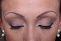 Eyebrow tattoos close up of and eyelashes Stock Image