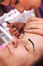 Eyebrows trimming Royalty Free Stock Photo