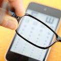 Eyechart on mobile with eyewear Royalty Free Stock Photo