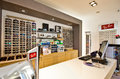 Eyeglass display of designer frames inside optician shop in koszalin poland Royalty Free Stock Images