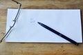 Eyeglass and pen on white envelope the Stock Image