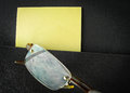 Eyeglasses in briefcase pocket with papers close up shot of eyeglass reflect blue sky Stock Image