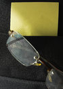Eyeglasses in briefcase pocket with papers close up shot of eyeglass reflect sky Stock Photo