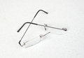 Eyeglasses with lightweight frame broken on white table Royalty Free Stock Images