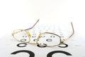 Eyeglasses on the ophthalmologic scale shallow dof Royalty Free Stock Images