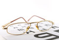Eyeglasses on the ophthalmologic scale shallow dof Stock Image