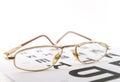 Eyeglasses on the ophthalmologic scale shallow dof Stock Image