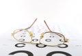 Eyeglasses on the ophthalmologic scale shallow dof Stock Photography