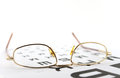 Eyeglasses on the ophthalmologic scale shallow dof Royalty Free Stock Photography