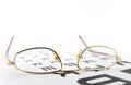 Eyeglasses on the ophthalmologic scale shallow dof Royalty Free Stock Photography