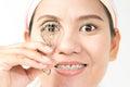 Eyelash curler young woman using Royalty Free Stock Photo