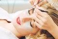 Eyelash extension procedure in beauty salon.