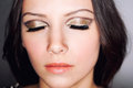 Eyes closed makeup young woman beauty with and golden Stock Image