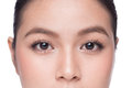 Eyes. Closeup of beautiful asian woman with brown eyes make up e Royalty Free Stock Photo