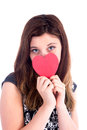 These eyes have seen love closeup of young woman in dress holding red heart covering her face Stock Photos
