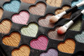 Eyeshadow heart shaped palette with applicators close up of Royalty Free Stock Photography