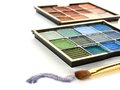 Eyeshadow set with trail and brush over a white background Royalty Free Stock Photography