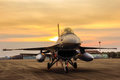F16 falcon fighter jet on sunset  background Royalty Free Stock Photo