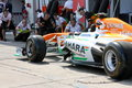 F photo formula force india car – stock photo race pitstop team mechanics work in paddock Royalty Free Stock Photos
