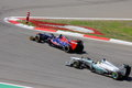 F photo formula one race cars – stock photos overtaking toro rosso jean eric vergne against mercedes nico rosberg Royalty Free Stock Image