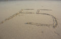 F5 refresh sign on sand Royalty Free Stock Photo