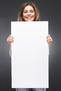 F young woman with blank white board portrait of on gray Royalty Free Stock Image