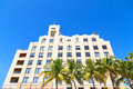 Façade of art deco building of miami beach florida palms and against a clear blue sky Stock Photos