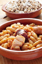 Fabada asturiana typical spanish bean stew closeup of an earthenware bowl with a Stock Photo