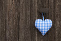 Fabric blue and white checked heart in bavarian style hanging on Royalty Free Stock Photo
