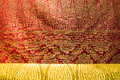 Fabric brunei red and gold pattern of Stock Photo