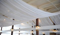 Fabric drape on the restaurant ceiling. Bright interior, lighted lantern. The decor for the wedding party
