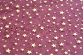 Fabric grunge christmas background with stars pattern Royalty Free Stock Photo