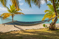 Fabric hammock by turquoise sea Royalty Free Stock Photography