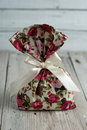 Fabric pouch tied with ribbon on old wooden table Royalty Free Stock Photos