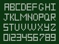Fabric script on deep green knitted background. Royalty Free Stock Photo